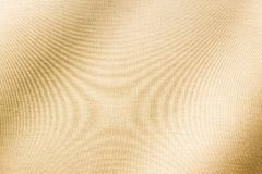 Shining gold from fabric surface stock photography
