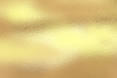 Shining gold foil. Yellow metallik texture background stock images