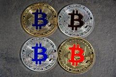 BTC Bitcoin coins. Shining gold and silver metal BTC Bitcoin coins on grey background Stock Photo