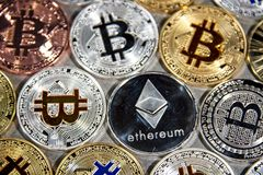 BTC and ETH, Bitcoin and Ethereum coins royalty free stock photos