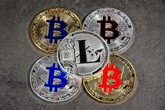 BTC LTC ETH Bitcoin Litecoin Ethereum coins. Shining gold and silver metal BTC LTC Bitcoin Litecoin coins on grey background stock images