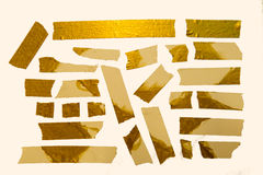 Shining Gold Tape Pieces. A collection of Home-Made Gold paper tape pieces royalty free stock photography