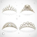 Shining gold tiaras with diamonds and pearls Stock Images