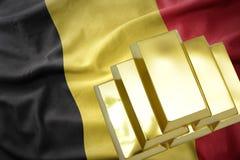 Shining golden bullions on the belgium flag royalty free stock photography