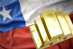 Shining golden bullions on the chile flag stock photography