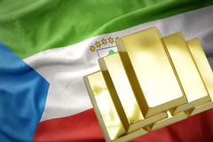 Shining golden bullions on the equatorial guinea flag Royalty Free Stock Image
