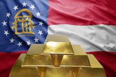 Georgia gold reserves. Shining golden bullions on the georgia flag background Stock Images