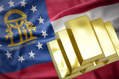 Shining golden bullions on the georgia state flag Stock Image