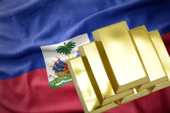 Shining golden bullions on the haiti flag. Gold reserves. shining golden bullions on the haiti flag background royalty free stock photography