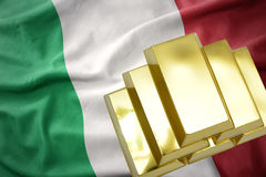 Shining golden bullions on the italy flag Stock Images