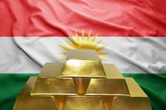 Kurdistan gold reserves. Shining golden bullions on the kurdistan flag background Stock Photography