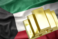 Shining golden bullions on the kuwait flag stock image