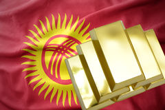 Shining golden bullions on the kyrgyzstan flag Royalty Free Stock Photography