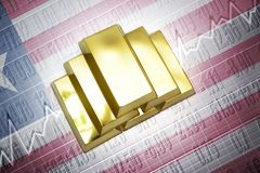 Liberian gold reserves. Shining golden bullions lie on a liberian flag background Royalty Free Stock Photos