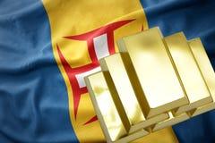 Shining golden bullions on the madeira flag Stock Photos