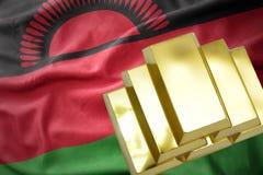 Shining golden bullions on the malawi flag. Gold reserves. shining golden bullions on the malawi flag background Stock Photos