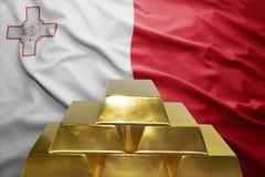 Maltese gold reserves. Shining golden bullions on the maltese flag background Royalty Free Stock Images
