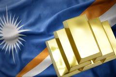 Shining golden bullions on the Marshall Islands flag Stock Photography