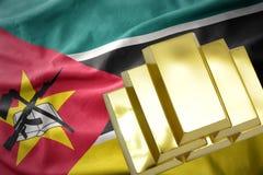 Shining golden bullions on the mozambique flag Royalty Free Stock Photo
