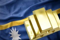 Shining golden bullions on the Nauru flag Royalty Free Stock Photos