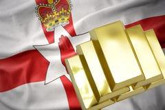 Shining golden bullions on the northern ireland flag Royalty Free Stock Photography