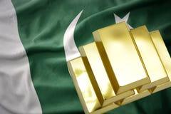Shining golden bullions on the pakistan flag Stock Photography