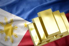 Shining golden bullions on the philippines flag Royalty Free Stock Images