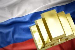 Shining golden bullions on the russia flag. Gold reserves. shining golden bullions on the russia flag background.3D illustration Stock Image