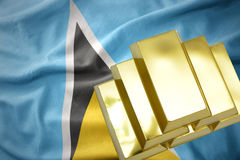 Shining golden bullions on the saint lucia flag royalty free stock photos