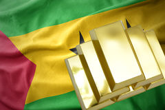Shining golden bullions on the sao tome and principe flag. Gold reserves. shining golden bullions on the sao tome and principe flag background Royalty Free Stock Images