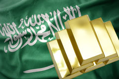 Shining golden bullions on the saudi arabia flag Stock Photography