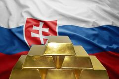 Slovak gold reserves. Shining golden bullions on the slovak flag background royalty free stock photo