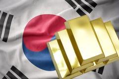 Shining golden bullions on the south korea flag. Gold reserves. shining golden bullions on the south korea flag background stock photo