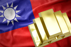 Shining golden bullions on the taiwan flag. Gold reserves. shining golden bullions on the taiwan flag background royalty free stock photography