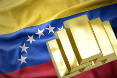 Shining golden bullions on the venezuela flag. Gold reserves. shining golden bullions on the venezuela flag background royalty free stock images