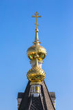 Shining golden cupola of orthodox church under blue sky Royalty Free Stock Photography