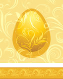 Shining golden egg on the decorative background Royalty Free Stock Photos