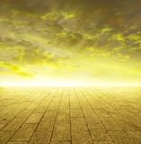 Shining golden horizon. Of  tiled stone ground and gold sky with grungy touch Stock Photo
