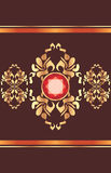 Shining golden ornament with red gemstone on the dark brown background Stock Photography
