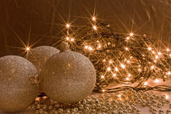Shining golden ornaments and Christmas lights garl Stock Photography