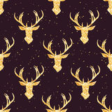 Shining golden reindeer seamless vector pattern. Shimmering glitter simple and stylish Christmas celebration design print. Speckled background Royalty Free Stock Photos
