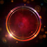 Shining golden rings over red background. Abstract golden rings shining over dark red background with stars and lights Royalty Free Stock Images