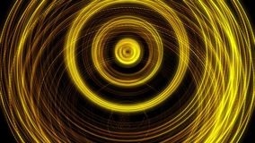 Shining golden rings in pulsating motion on black background, seamless loop. Animation. Abstract yellow shimmering