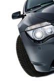 Shining headlight of a modern black car Stock Image