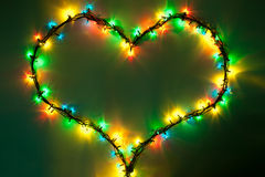 Shining heart. On dark green background. Valentine's Day Stock Photography