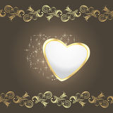 Shining heart on the dark brown decorative background Stock Photo