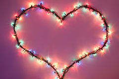 Shining heart on dark pink background. Valentine's Day Royalty Free Stock Photo