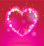 Shining heart. On red background Stock Photos