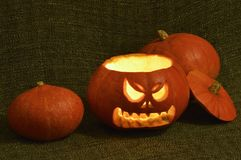 Shining horror Halloween pumpkin. Scary halloween pumpkin without cover Royalty Free Stock Photo