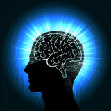 Shining a human head with a glowing outline of the brain and radiating waves, aura